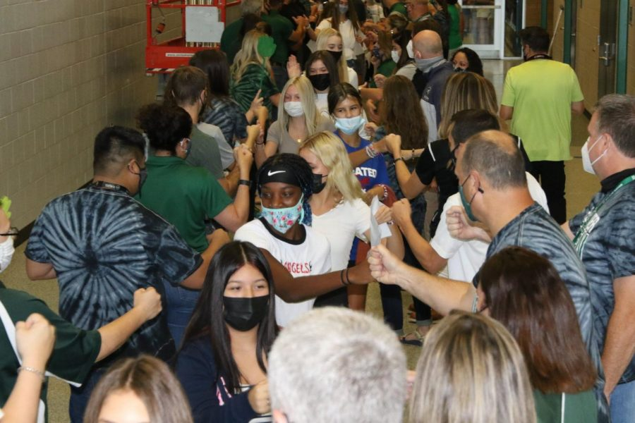 Incoming freshman go through the gauntlet, shaking their future teachers hands, on August 12, 2021.