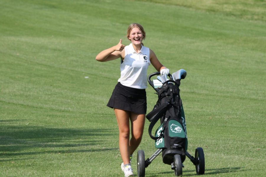 Sophomore Maggie Bichelmeyer poses for a picture during the golf tournament at Painted Hills on Sept. 9.