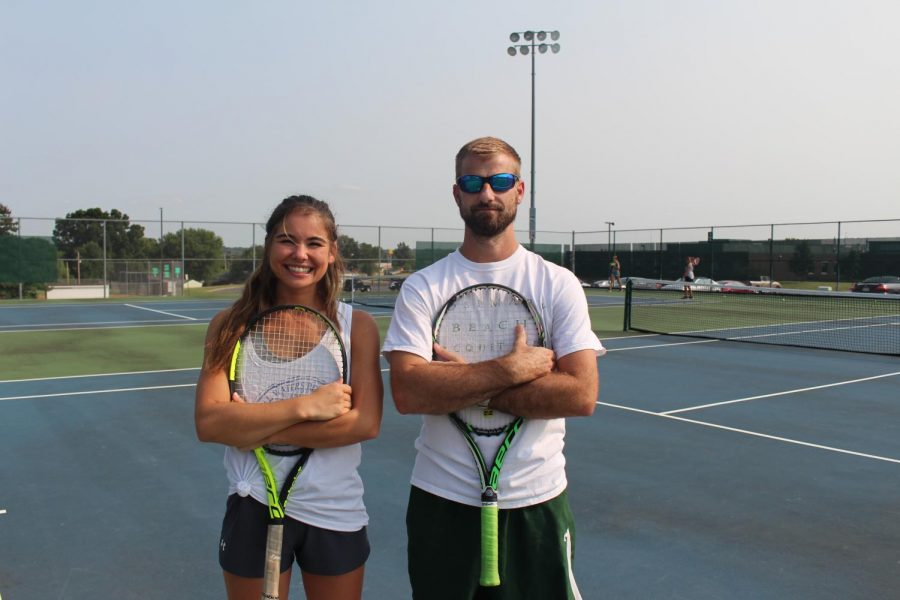 New assistant coach Emily Parr poses for a picture with head coach Justin Hoffman on the De Soto High School tennis courts on Sept. 1.