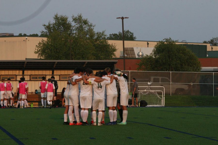 The+De+Soto+High+School+boys+soccer+team+huddles+before+their+game+against+Mill+Valley+on+Sep.+7.+
