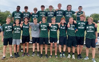 The DHS boys cross country team poses for a picture at the KC Metro Classic on Oct. 2.